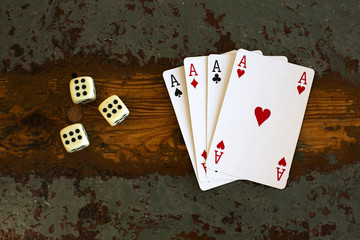 cards '4 aces' and dice