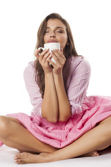 young beautiful woman enjoying the smell of morning coffee