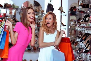 Beautiful young women in shop