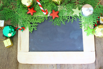 Beautiful Christmas decoration and chalkboard on wooden background