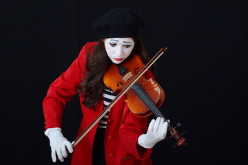 the girl is MIME playing the violin