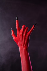 Scary devilish hand showing heavy metal gesture
