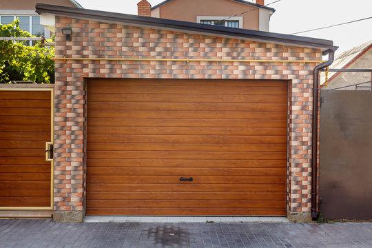 Wooden Garage Door with colored brick wall background