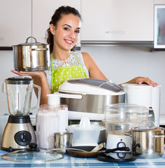 Girl with kitchen appliances at home.