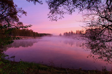 Pink sunrise on the lake