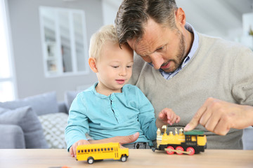 Daddy with baby playing with toy cars