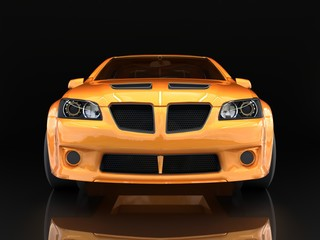 Sports car front view. The image of a sports gold car on a black