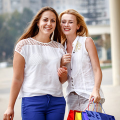 attractive happy women do shopping