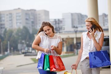 attractive happy women do shopping
