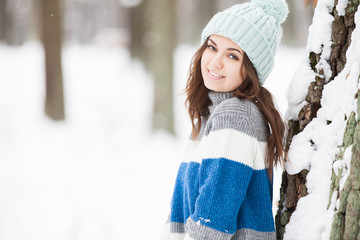 Attractive young woman in winter park