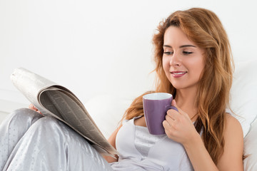 Woman reading morning newspapres
