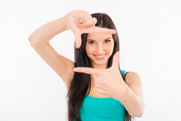 happy young woman gesturing finger frame and smiling