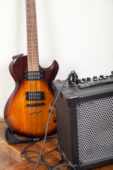 electric guitar and amplifier with cable