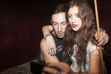Young couple taking selfies on a cell phone