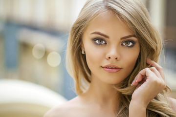 Portrait of attractive young blonde woman