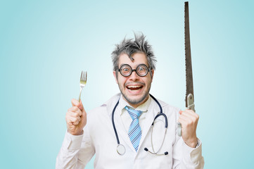Funny wacky and crazy surgeon doctor holds unusual surgical instruments