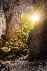 Cetatile cave sculpted by river in romanian mountains at sunset