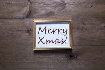 Golden Picture Frame With Copy Space And Text Merry Xmas
