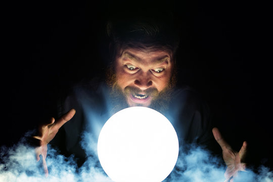 Dark wizard is making magic with the magic crystal.