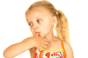 Blond girl wearing a swimsuit with her thumb in her mouth