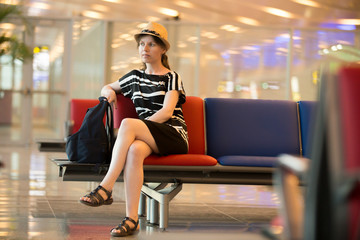 Young female traveler waiting for journey