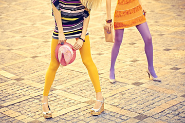 Fashion urban people, friends, outdoor. Womens on paving stone