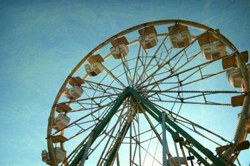 aged and worn retro photo of ferris wheel