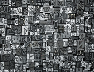Letterpress background, close up of old metal letters