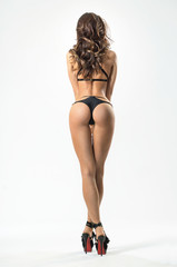 Back view of sexy woman in a black lingerie