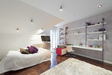 Interior of a modern teenage room in loft apartment
