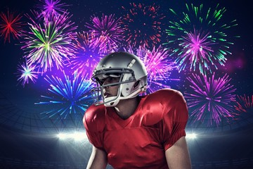 American football player against fireworks