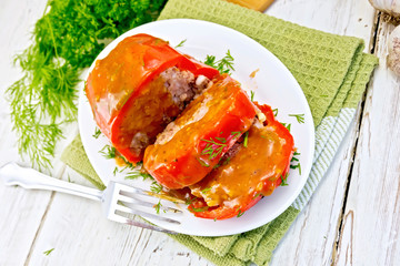 Pepper stuffed meat with sauce in plate on table