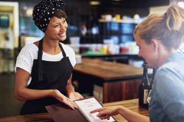 Customer checking a wine menu