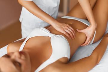 Spa treatment.  Body care. Masseur doing massage on woman body in the spa salon.