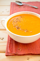 Vegetarian carrot-pumpkin cream soup with garlic and cumin