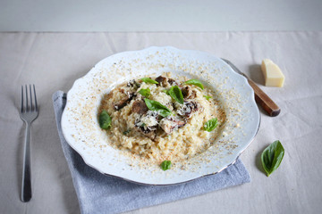 Foie gras and wild mushroom risotto with parmesan and basil