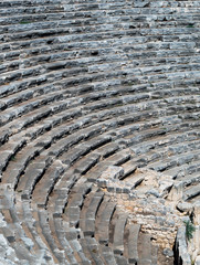 Old antique theater - amphitheater with tribunes.