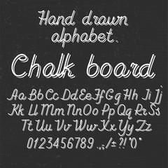 Hand drawin alphabet handwritting abc font on blackboard. Italic