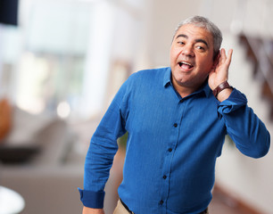 portrait of a mature man trying to hear something