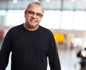 portrait of a mature man wearing glasses