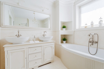 Elegant bathroom with white fittings