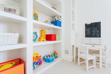 White furnitures in child room