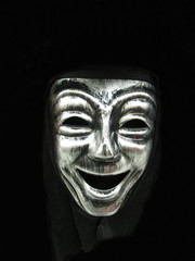 Smiling carnival face mask, part of a Halloween costume.