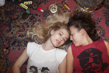 Portrait of two playful young women