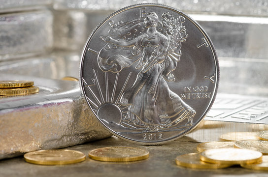 United States Silver Eagle with Gold coins & silver bars in back