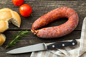 Chorizo sausage on wooden table