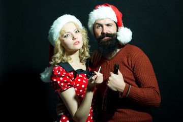 Christmas couple with bottle and cigarette