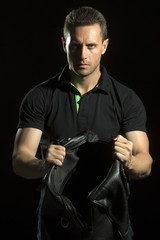 Strong muscular man with bag
