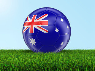 Soccer football with Australian flag on grass. Image with clipping path