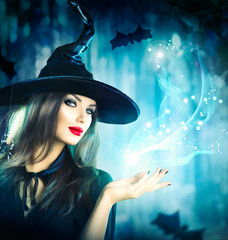 Halloween Witch holding magical light in her hand